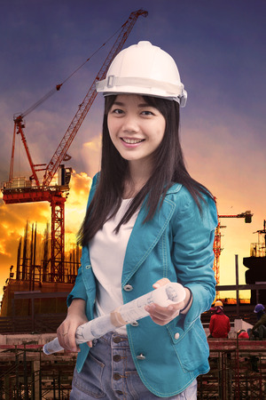 female engineer with construction plant against building stucture site plant photo