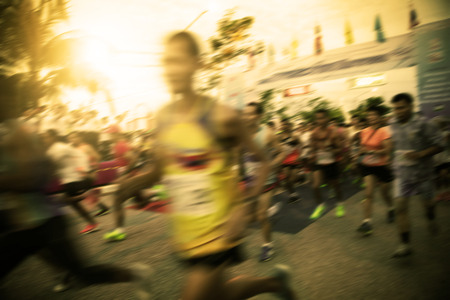 excercise: blur of marathon runner at start point  begin the competition