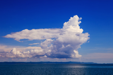 cloudscape: beautiful fantasy white cloud on blue sky use as natural background of cloudscape over blue sea level Stock Photo