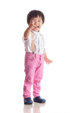 face of asian children laughing with happiness emotion isolated white with studio light photo