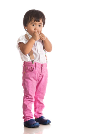 children acting: face of asian children acting by hand and face isolated white background with studio lighting