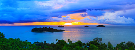 koh: panorama scene of raining clouds and sun set sky behind koh chang island in trat province eastern sea of thailand