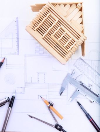 writing instrument: architect working table with plan home model and writing instrument and paper work