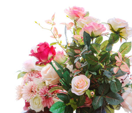beautiful artificial roses flowers bouquet arragngement isolated white background photo