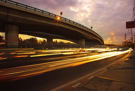 lighting of vehicle running on asphalt roads against beautiful dusky sky