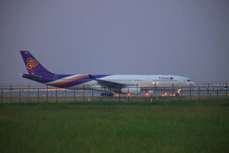 runways: BANGKOK THAILAND NOVEMBER 21 : Thai airways plane ready to take off at Suvarnabhumi international Airport  runways on november 21,2014 Bangkok Thailand