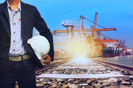 land use: working man in port shipping transport and train land logistic use for transportation industry background Stock Photo