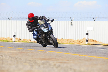 sharp curve: young man riding big bike motorcycle on sharp curve asphalt road use for biker activity and rider traveling topic Stock Photo