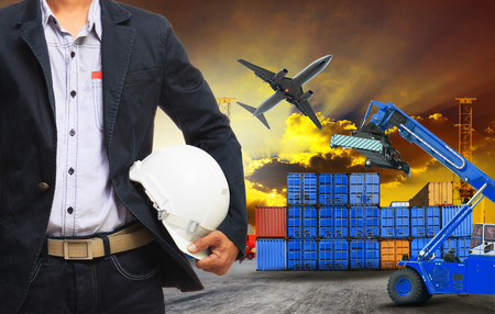 air freight: working man and container dock in land ,air cargo logistic freight industry