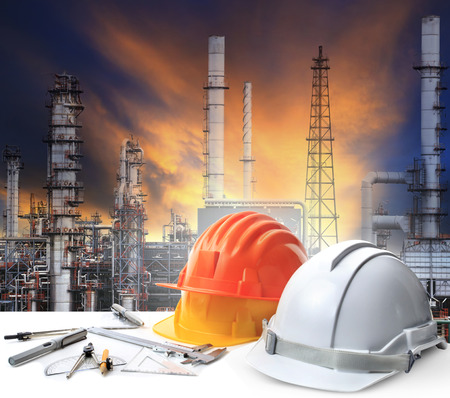 energy use: engineer working table in oil refinery plant heavy petrochemical industry estate use for energy,power,fuel ,gas and fossil petroleum topic