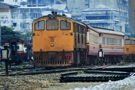 railroads: front view of old diesel trains running junction of railroads track against urban land transport scene