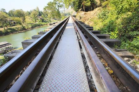 wood railways: perspective of old wood bridge railways in kanchanaburi thailand important landmark of world war II history Stock Photo