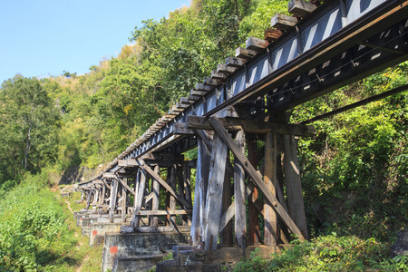 infra construction: old wood structure of dead railways bridge importand landmark and destination of world war II history in kanchanaburi thailand and now is famous visiting point of visitor in thailand