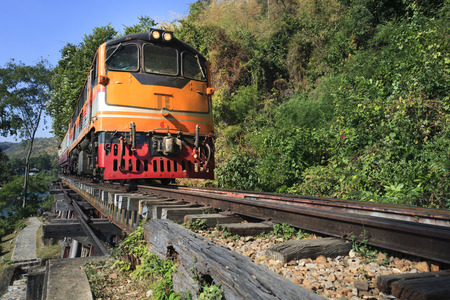 infra construction: trains running on death railways track crossing kwai river in kanchanaburi thailand this railways important destination of world war II history builted by  soldier prisoners