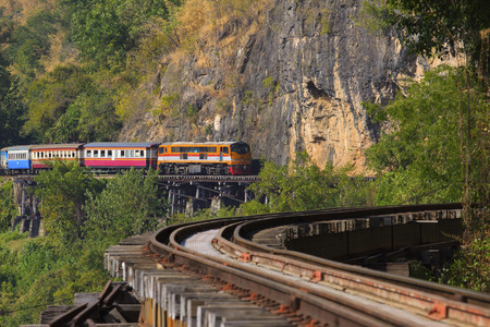 infra construction: thai trains running on death railways crossing kwai river in kanchanaburi western border of thailand-burma (myanmar) important landmark and destination to visiting ,and world war II history builted by soldier prisoner