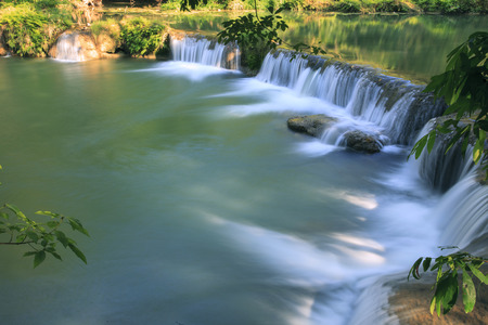 beautiful waterfalls in pure deep forest of thailand national park photo