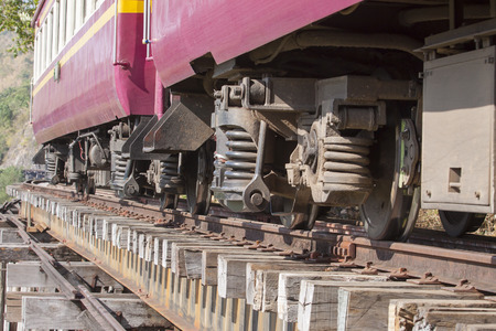 wood railways: lower view of trainst suspension on old wood railways bridge