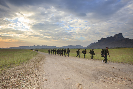 patrolling: LOPBURI THAILAND-Dec25: thai army soldier practice to long range patrolling across open country of no man land on december25,2014 in Lopburi Province Thailand