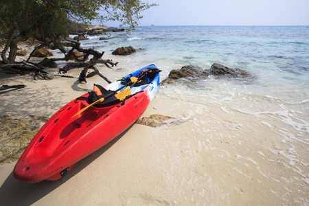 sea kayak canoe on sea sand beach with beautiful nature coast beach background use for activities and adventure sport outdoor theme background