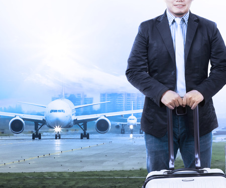 young man and traveling luggage staning in front of air plane taxi on airport runways preparing to fly use  image as people journey by air transport background