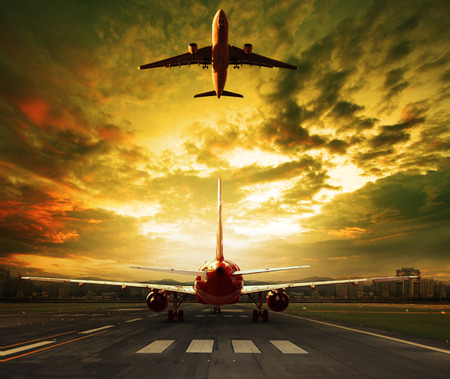 runways: passenger plane ready to take off on airport runways with urban office building background iuse for traveling ,cargo ,air transport ,business Stock Photo