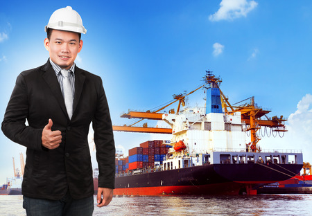 comercial: business man and comercial ship with container on port use for import ,export and shipping logistic industry service