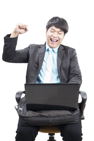 young business man working by internet online with laptop computer and fists up acting happy face isolated white background photo