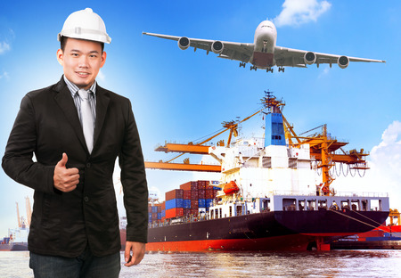 business man and comercial ship with container on port freight cargo plane flying above use for import ,export and shipping logistic industry service