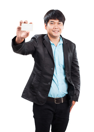 trust people: young businss man standing with happy face holding name card in hand and showing to people use for business trust and health insurance Stock Photo