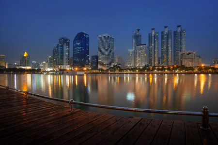 city scape: city scape of benchakitti public park important landmark in heart of bangkok thailand and free space for people resting area and beautiful city scape reflect on  water pool Stock Photo