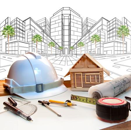 Mesa de trabajo arquitecto y dos perspectivas punto uso plan de moderno edificio de ingeniería de construcción y bienes raíces, industria de desarrollo de la tierra Foto de archivo - 35216270