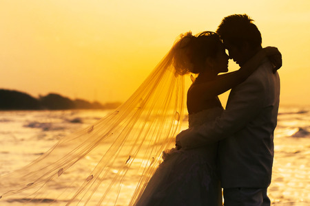 groom and bride in love emotion romantic moment on the beach photo