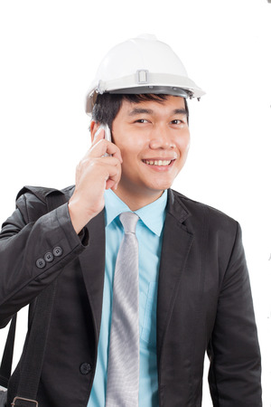 communicated: engineer man talkin on mobile phone and smiling with happy emotion isolated white background use for people working on career and modern occupation Stock Photo