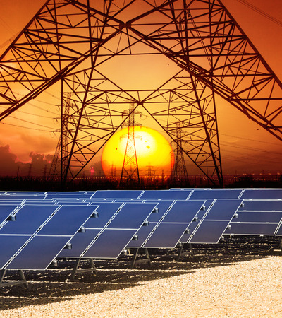 solarcell: sun set with structure of high voltage electric power tower and solar cell panel in energy farm Stock Photo