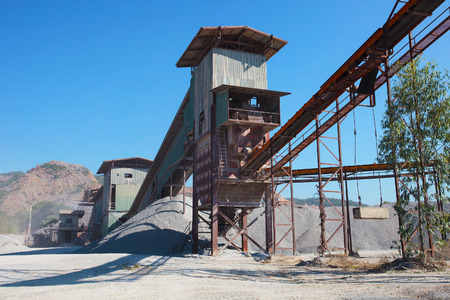 sand quarry: rock crusher machine industry chain moving to logistic gravel use for construction matterial and pollution of heavy industry Editorial
