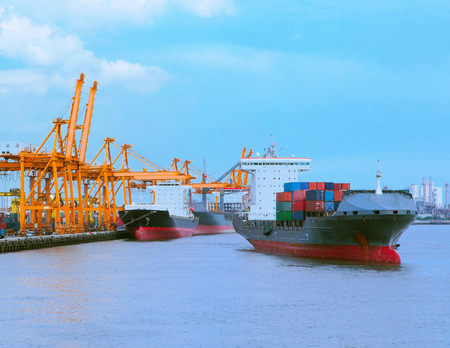 comercial: comercial ship with container on shipping port for import export and logistic transportation Stock Photo
