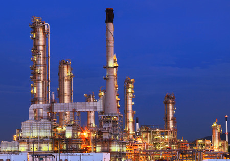 beautiful lighting of oil refinery plant in petrochemical heavy industry estate against clear blue sky use for energy power and fossil fuel topic photo