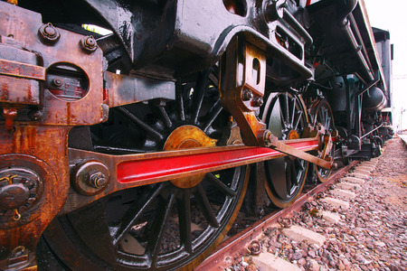 land use: iron wheels of stream engine locomotive train on railways track perspective to golden light forward use for old and classic period land transport and retro vintage style background