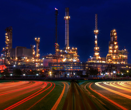 beautiful lighting of oil refinery plant in industry estate against blue sky of night