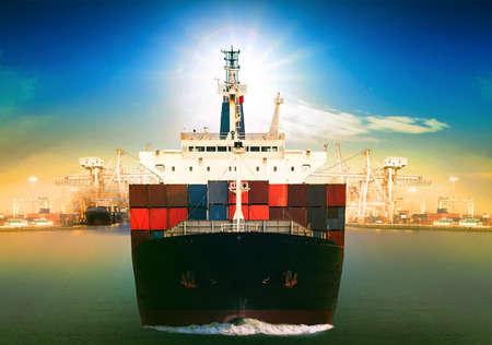 blue vessels: commercial vessel ship and port container dock behind use for freight water transport and logistic shipping business theme