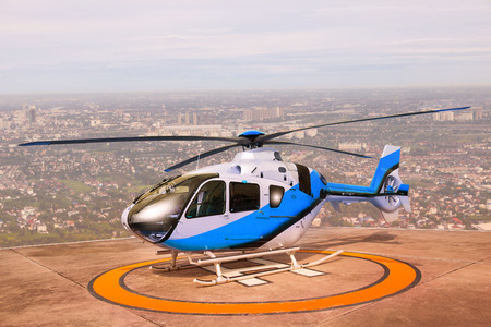 helicopter pilot: helicopter parking on building roof top use for commercial air transportation and aviation traveling Stock Photo