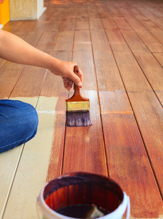 wood floor: hand painting oil color on wood floor  use for home decorated ,house renovation and housing construction theme Stock Photo