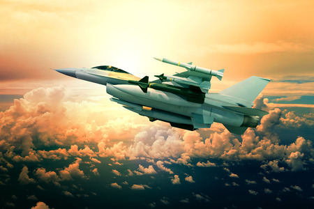 battle plane: military jet plane with missile weapon flying against sunset sky