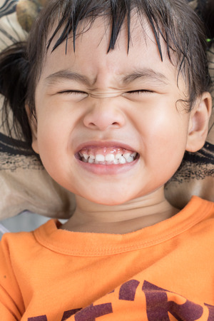 clouse up lovely face of good health children white teeth when open mouth use for healthy  and dental care Stock Photo
