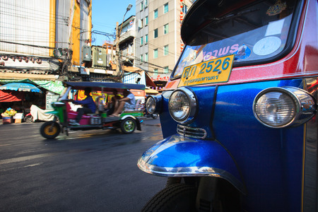 bangkok landmark: THAILAND,BANGKOK-FEB 24:TukTuk parking in Yaowarat Road main street in Chinatown,one of Bangkok landmark in bangkok on february24,2015 in China town, Bangkok Thailand