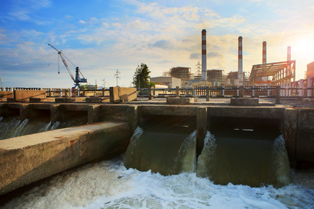 electric generating plant: scene of Thermal electric Power Plant and cool down water flowing to river good corperated and safe nature ,environment Stock Photo