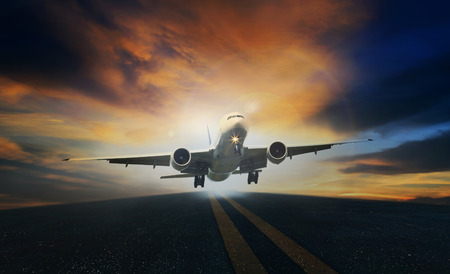 passenger plane take off from runways against beautiful dusky sky with copy space photo