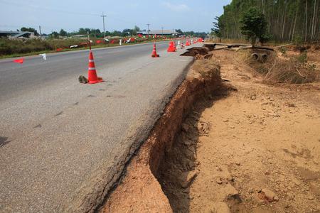 land slide: destruction of asphalt highways road after hard rain storm and flood water past