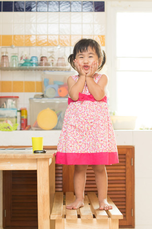 children acting: lovely acting of little children dinning table in home kitchen room use for happiness in people family