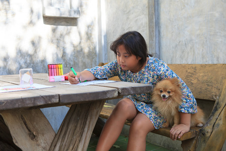 girl and pomeranian dog at home photo